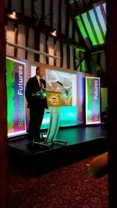 Presenter on stage building futures award
