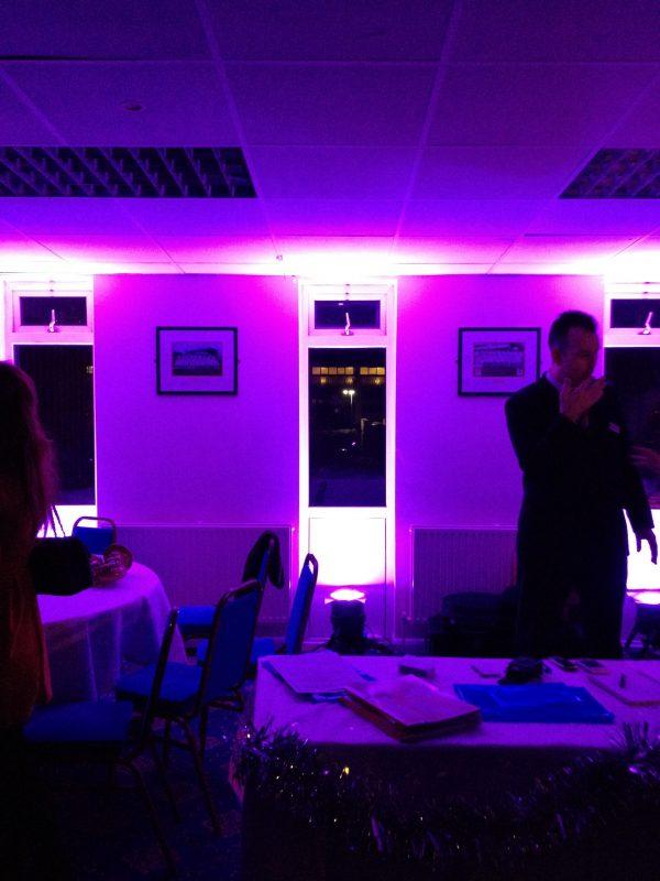 Uplighting set to purple, lights wall