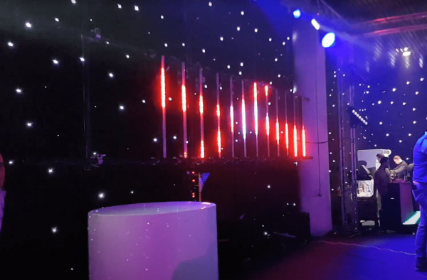 Led pixel bars creating a moving backdrop on stage
