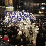 Stormtroopers inside st clements dane church which was lit with stage lights