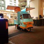 Three wheel tuk tuk set up in a hotel for motorola brand event